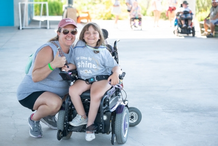 Camper and volunteer from MDA Camp enjoying time playing under the pavilion. Photo by: Beyond Memory Photography
