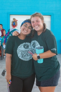 Two activity leaders smile at camera under the pavilion Photo by: Beyond Memory Photography
