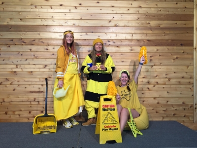 Amanda, Amelia, and Carleigh are dressed in different types of yellow costumes and clothing with yellow props to pull together a monochromatic portrait.