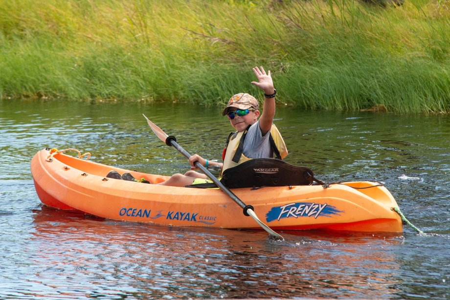 Camper from Camp MDA enjoying time kayaking in the Kayak Pond.